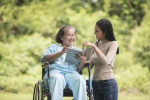 Women providing elderly care at home